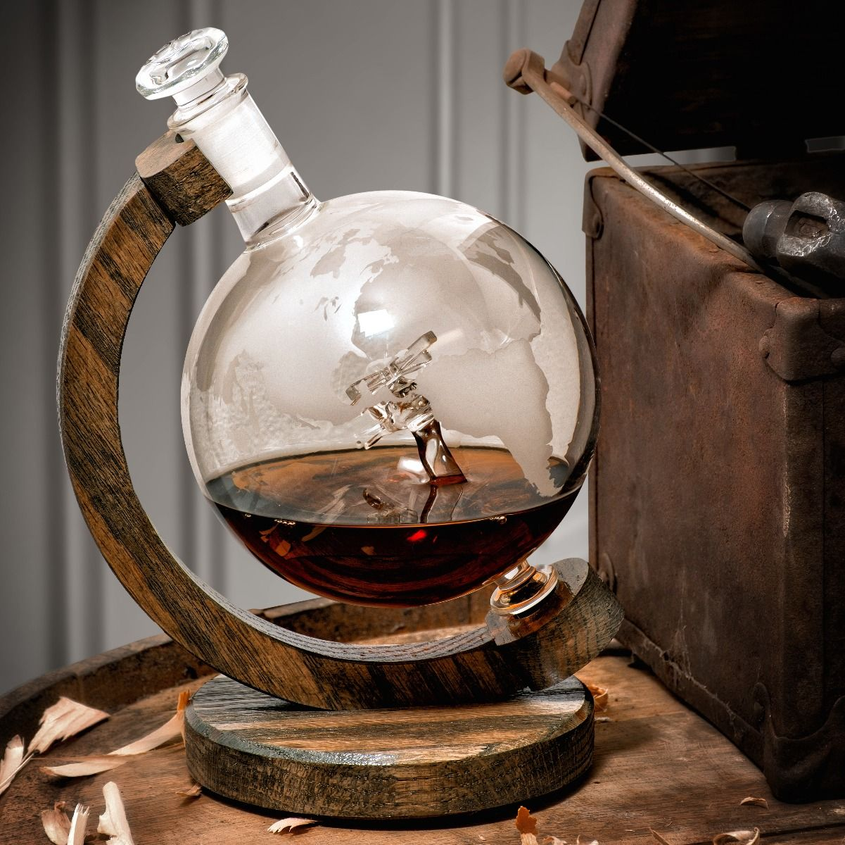 Etched glass globe wine decanter with hand blown helicopter