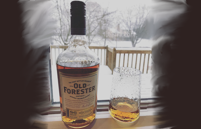 A glass of old forester bourbon